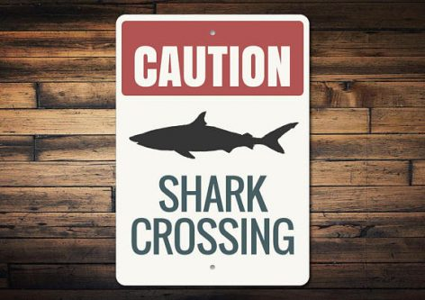 Gift ideas for shark lovers include this sign because sharks are indeed everywhere.