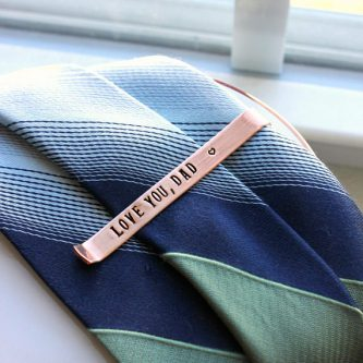 Father of the Groom Gifts include tie clips that are engraved with love.