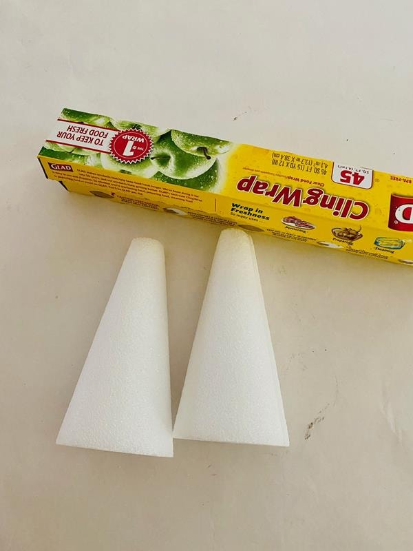Foam craft cones and cling wrap for making DIY Christmas decor