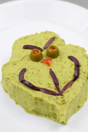 Grinch guacamole snack shaped treat for guests during the holidays